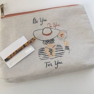 Anthropologie Hair clip and travel bag